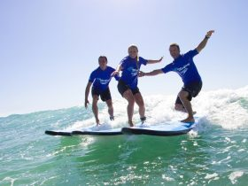 Three people surfing