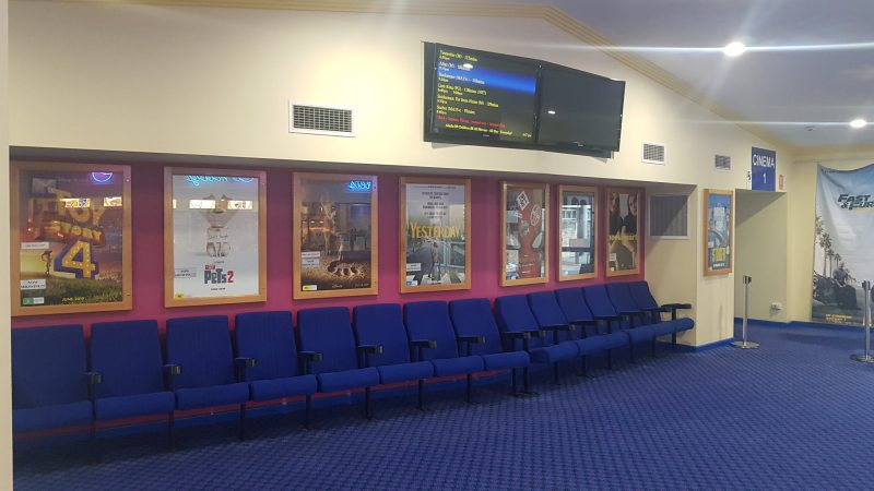 Waiting area with seating and movie posters