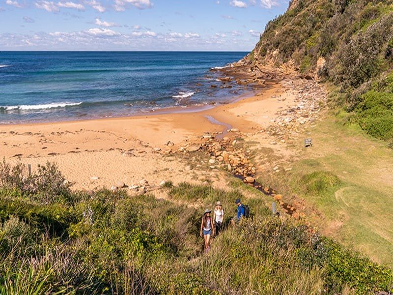 3 people walking up from the Little beach, Bouddi National Park. Photo: John Spencer/DPIE.