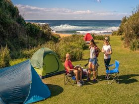 People nearby tents located at Little Beach campground, Bouddi National Park. Photo: John Spencer/DP