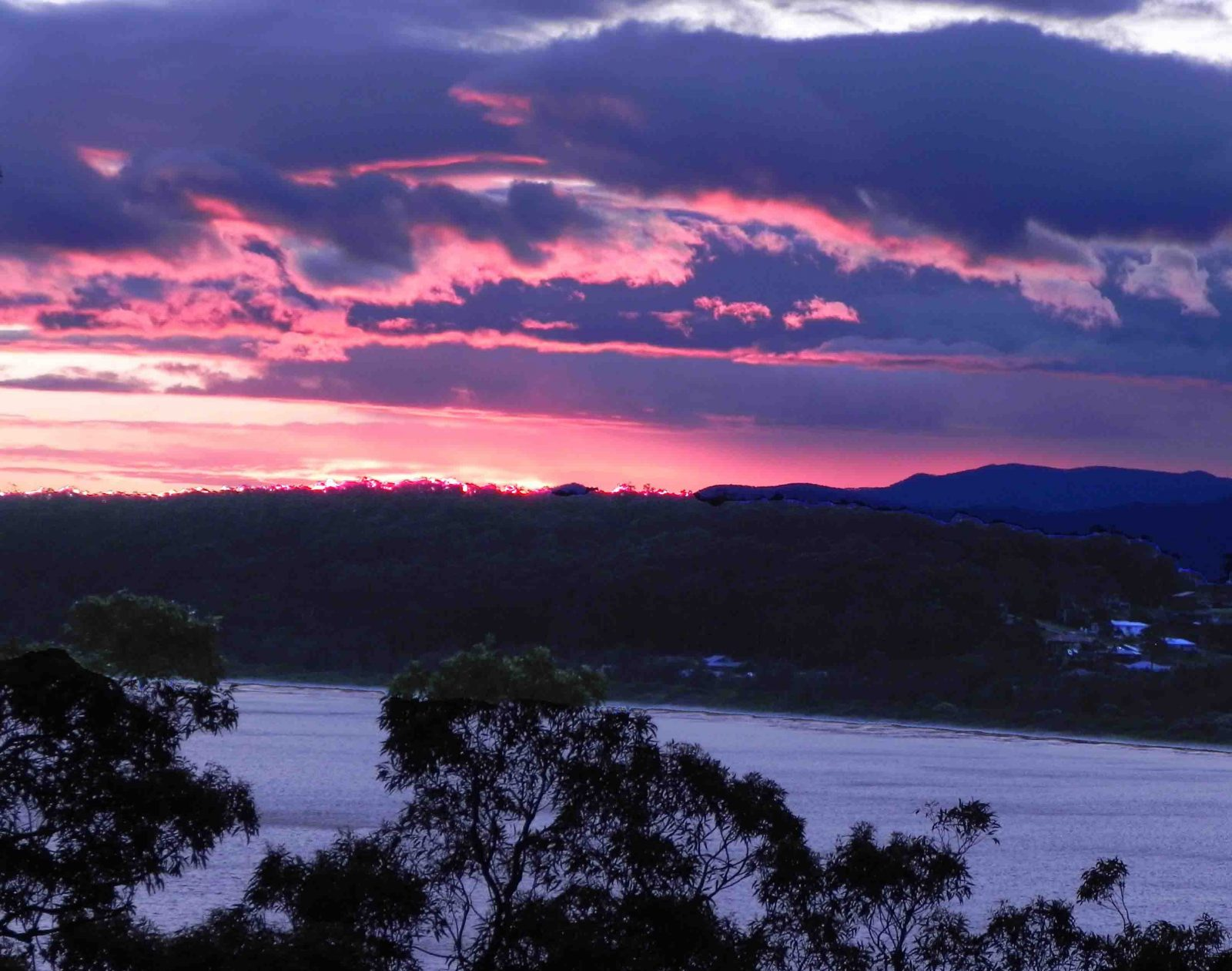 View of setting sun over Batemans Bay from the Apartments' upper deck at Longbeach Clifftop Retreat