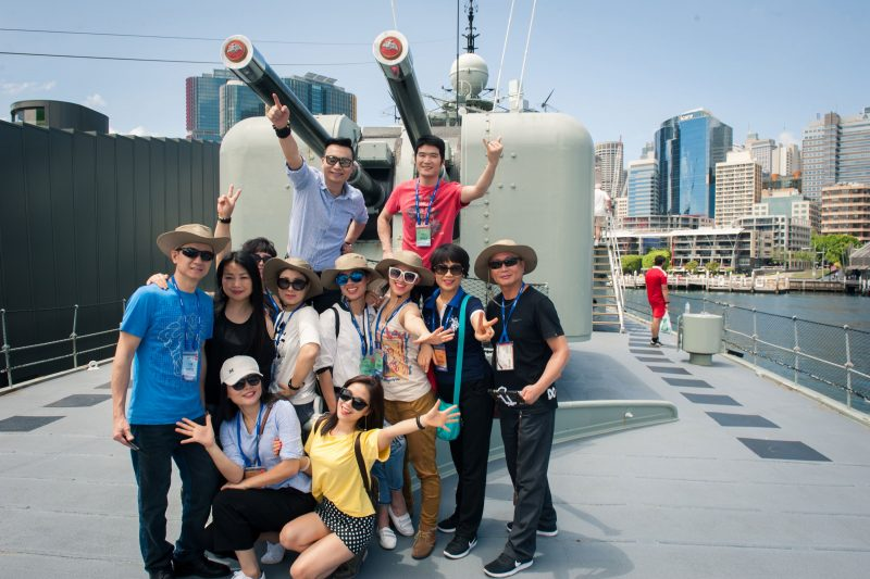 Chinese visitors pose for a photo on board ex-navy destroyer HMAS Vampire at the Maritime Museum