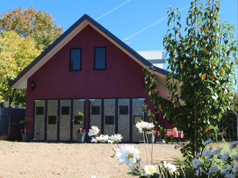 Art doors at front of Magenta Cottage