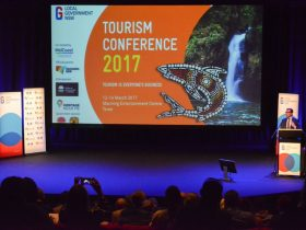 Past Tourism conference on the stage with the Tourism Minister