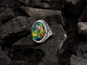 One of a kind Ring features a 25.10 carat lighting ridge Black Opal of exceptional quality.
