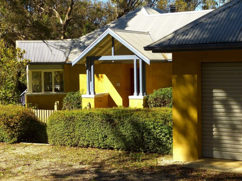 The entry is at the bottom of a winding drive surrounded by majestic gum trees and bird song