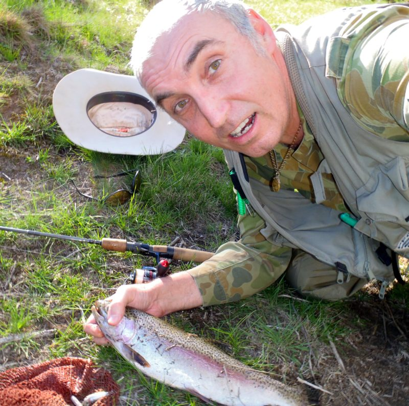 Man leaning down with his trout