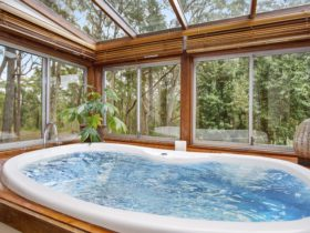 A large spa with views and a glass roof