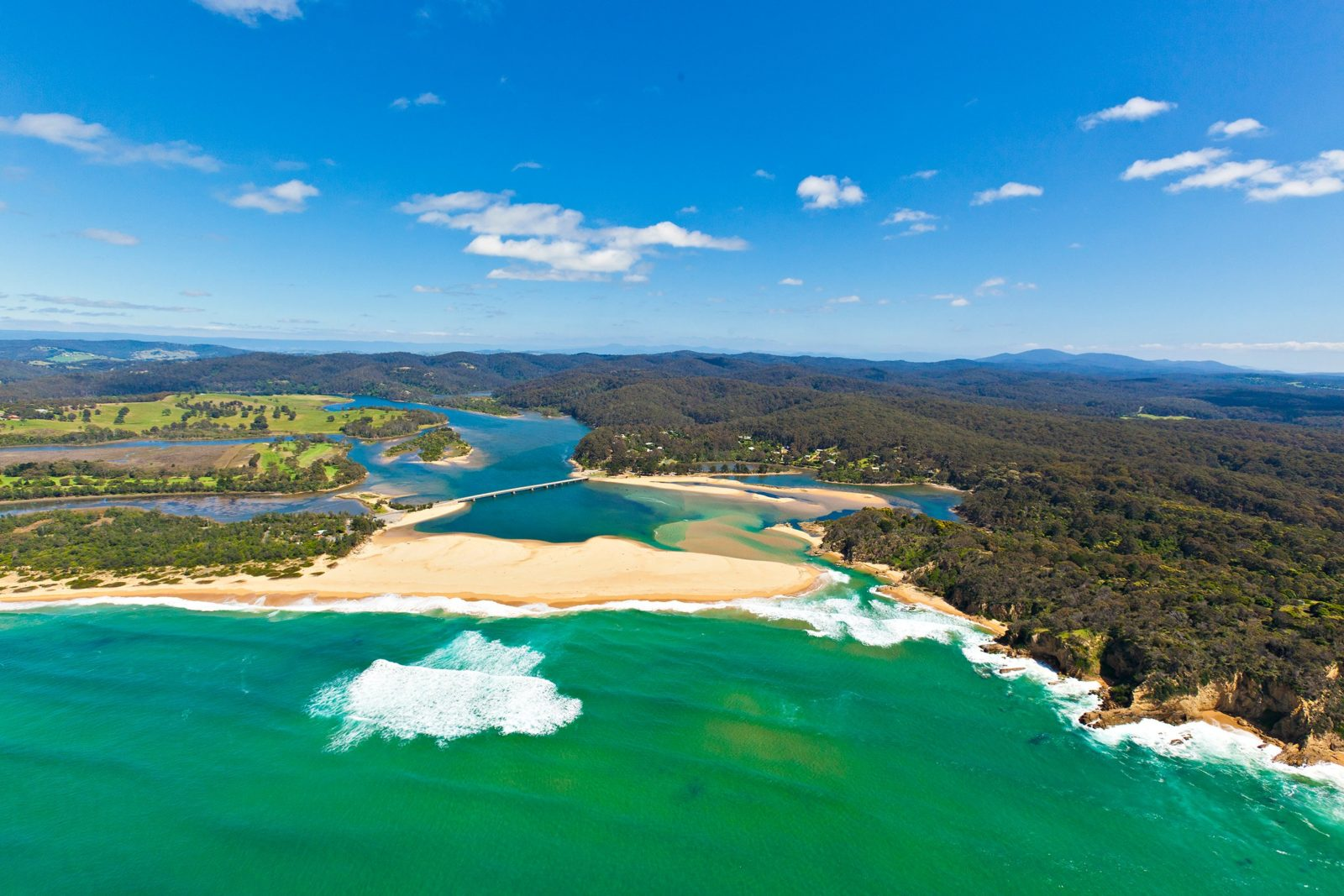 Aerial view of Mogareeka, where Bega River meets the sea, the southern gateway to Mimosa Rocks NP