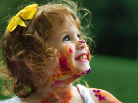 Young girl with paint on her face