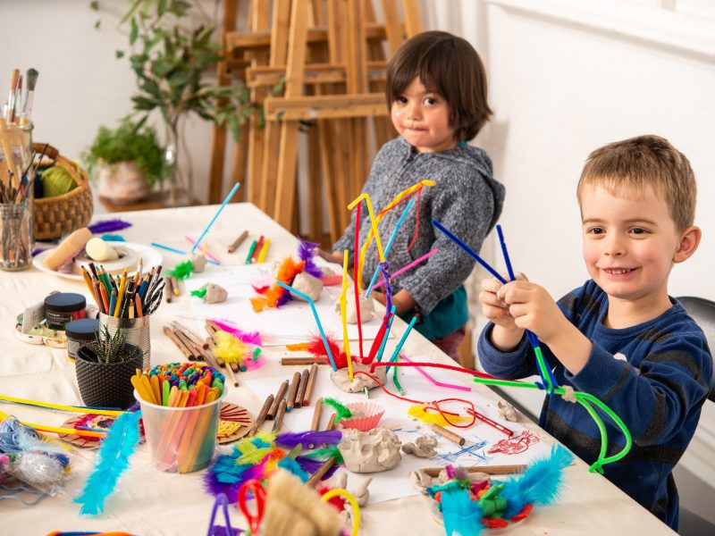 Two children with pipe cleaners making sculptures