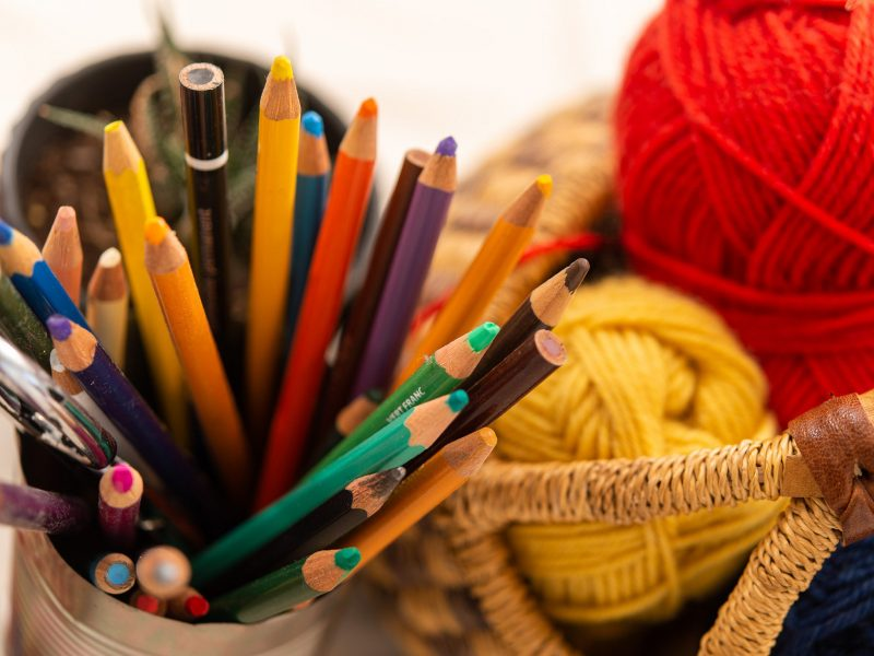 Pencils and a basket of wool on art studio table