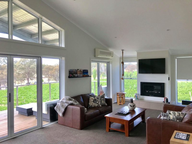 The Canopy Loft is accommodation for one or two couples. Views over the vines and to the lake
