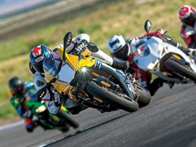 Motorcyclists racing on track