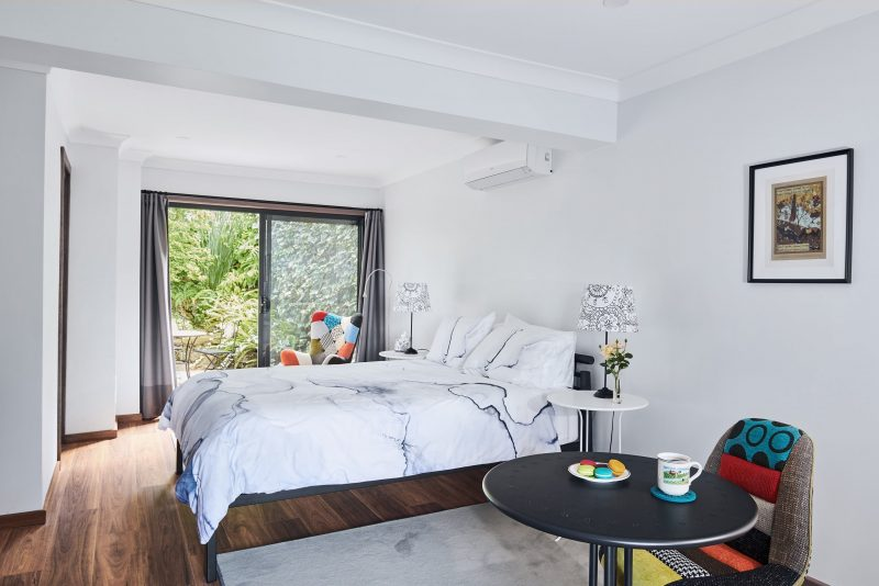 Studio apartment with queen size bed, table and chairs. Window out to courtyard.