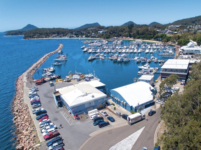 Arial photo Nelson Bay's Marina with NBFW as the prominent feature. Boats in the marina hills behind