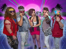 Never Ending 80s crew and their 80s style costumes.