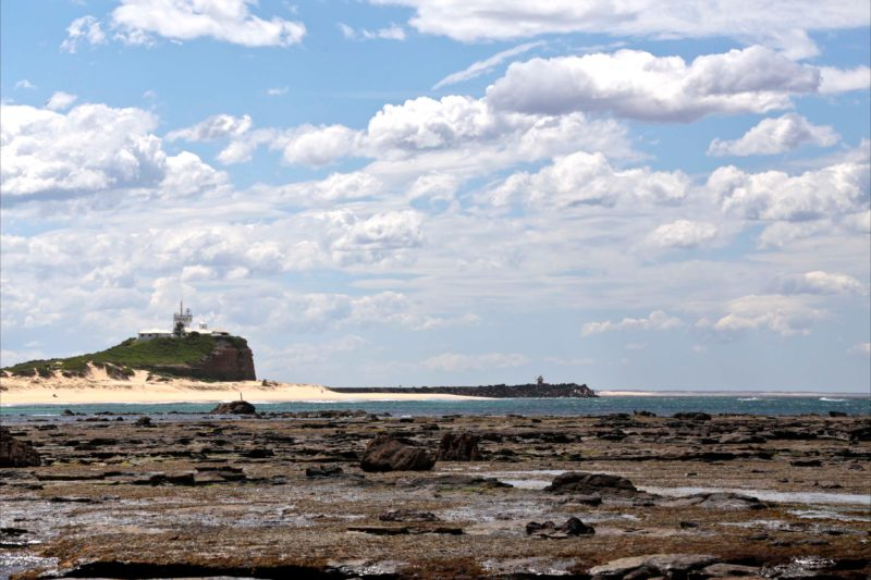Nobbys Beach leading up to Nobbys Lighthouse on the south entrance of the Port of Newcastle