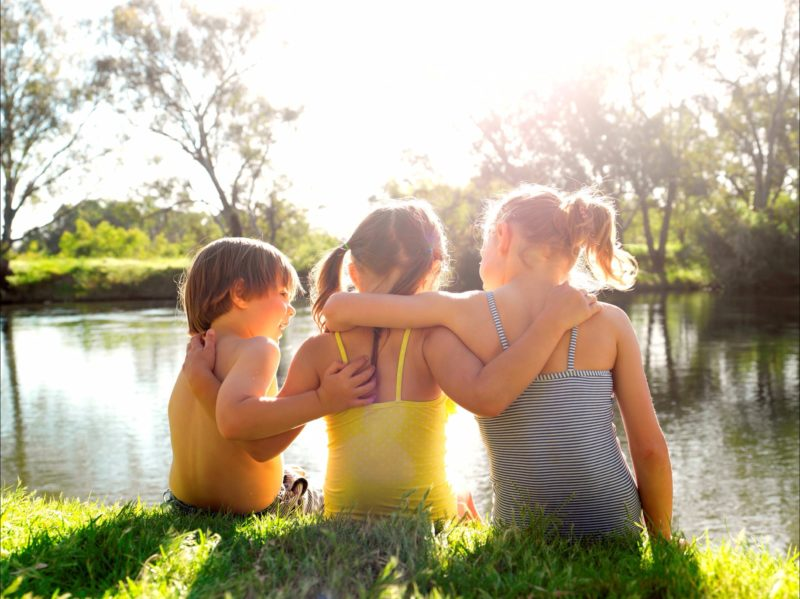 Children sitting on the banks of the Murray River