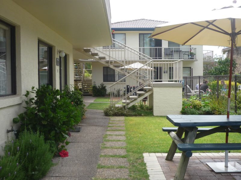 Outdoor area showing tables and lawn area