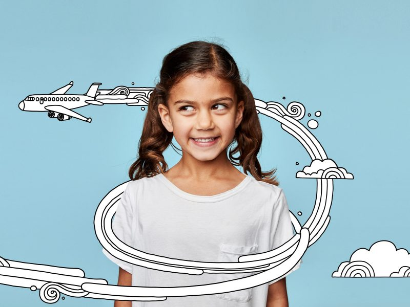 Girl with illustration of plane flying around her