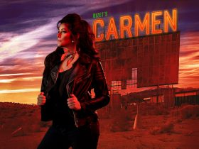 Hero image of Bizet's Carmen including main character against billboard with title