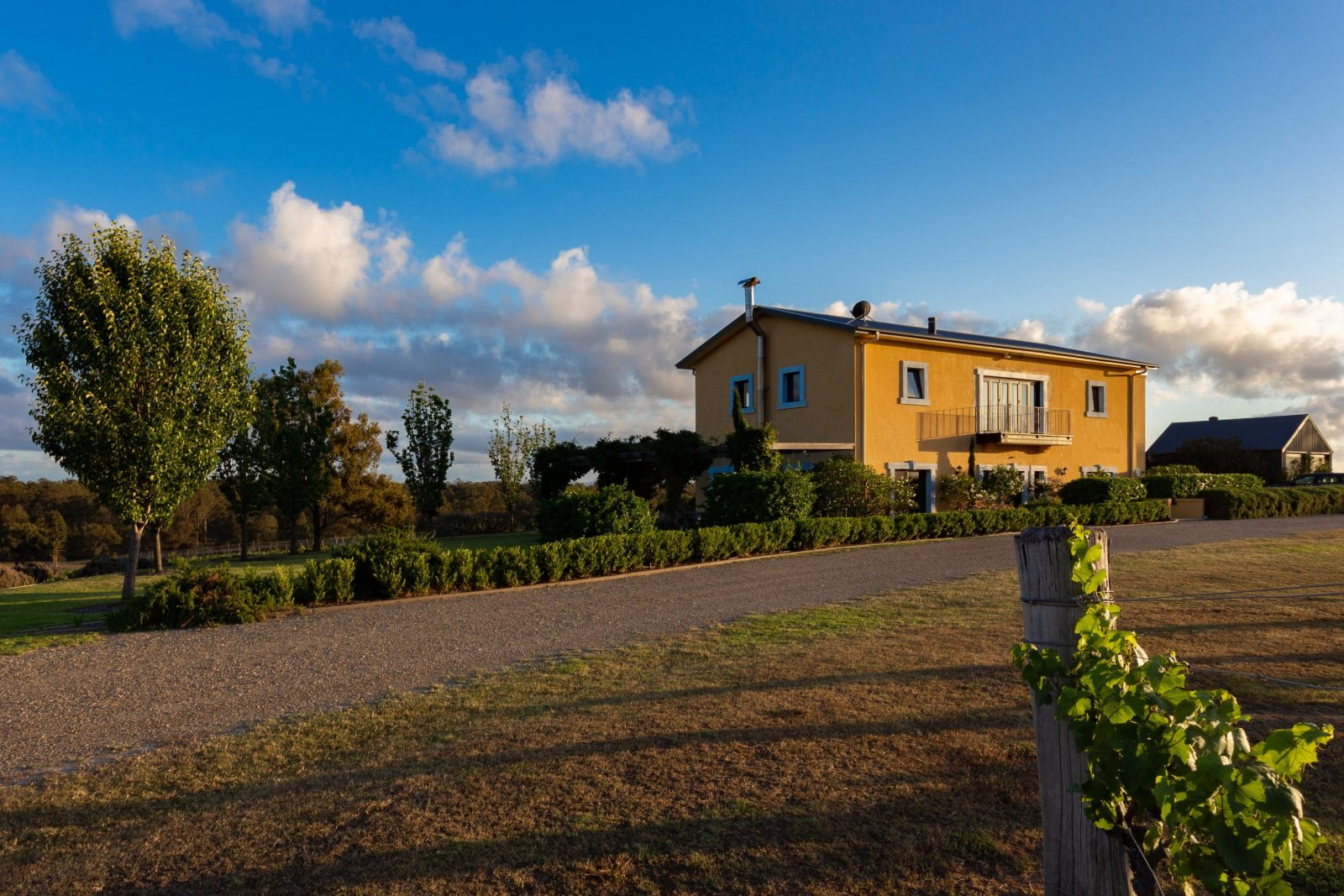 The yellow Tuscan villa on top of the hill