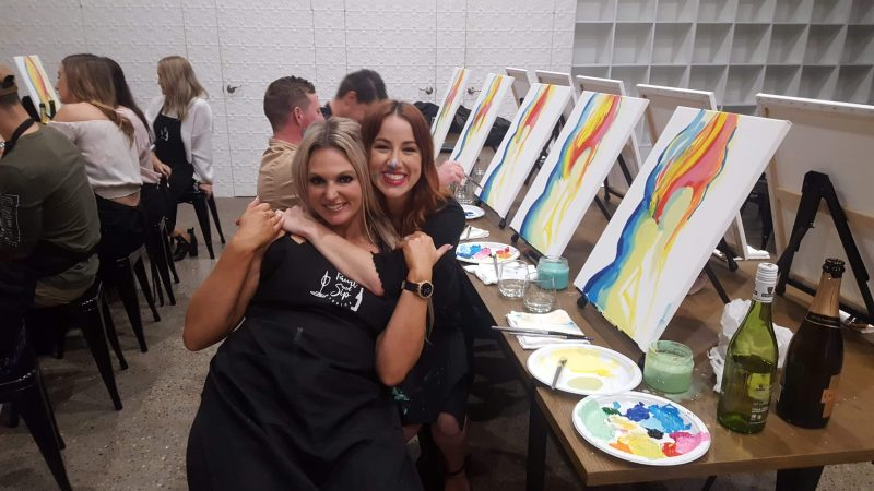 Friends having fun at Paint and Sip