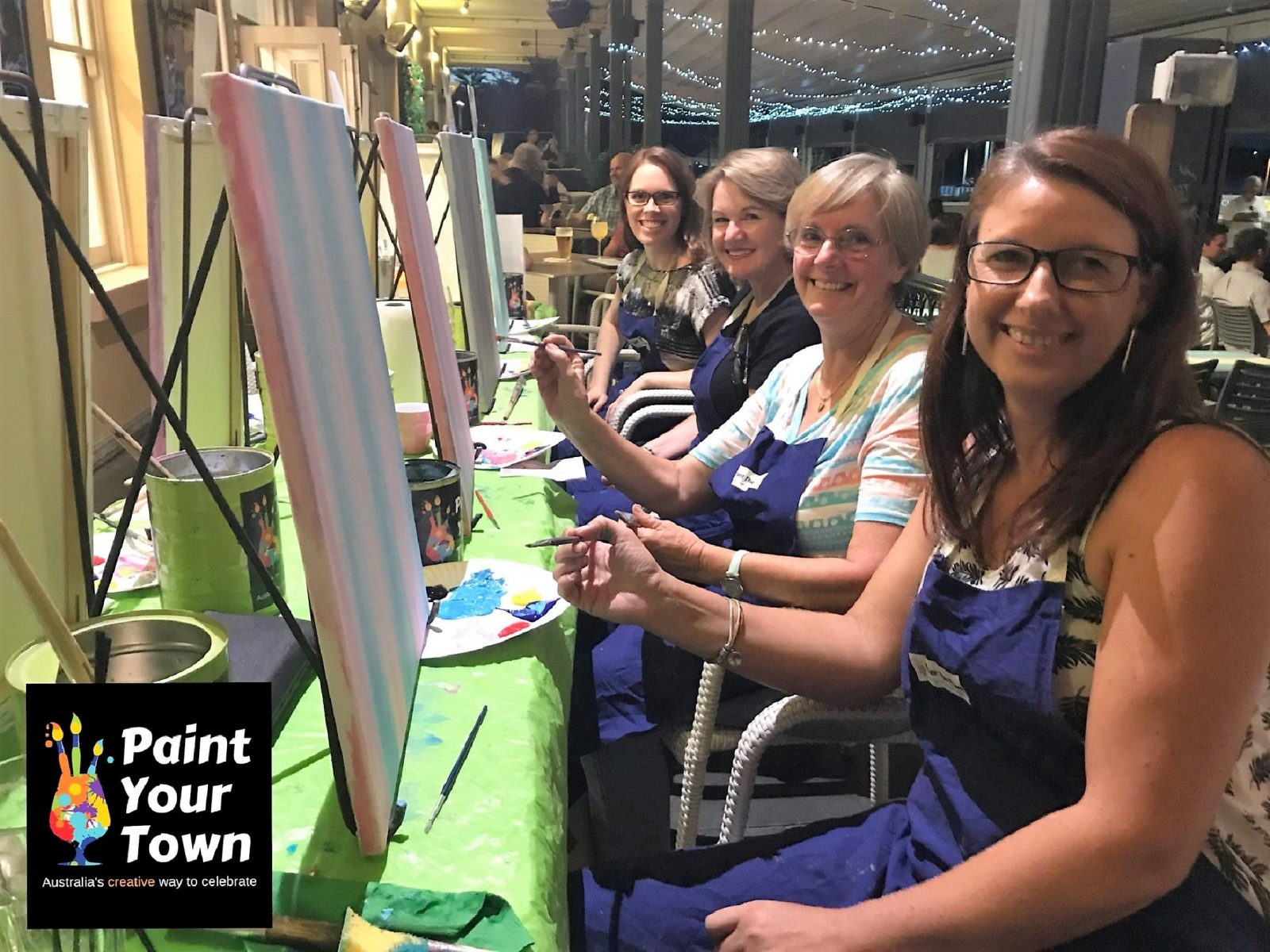 Group of ladies ready to paint, paint sip celebrate