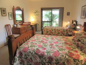 view of willow room showing queen bed and king single bed