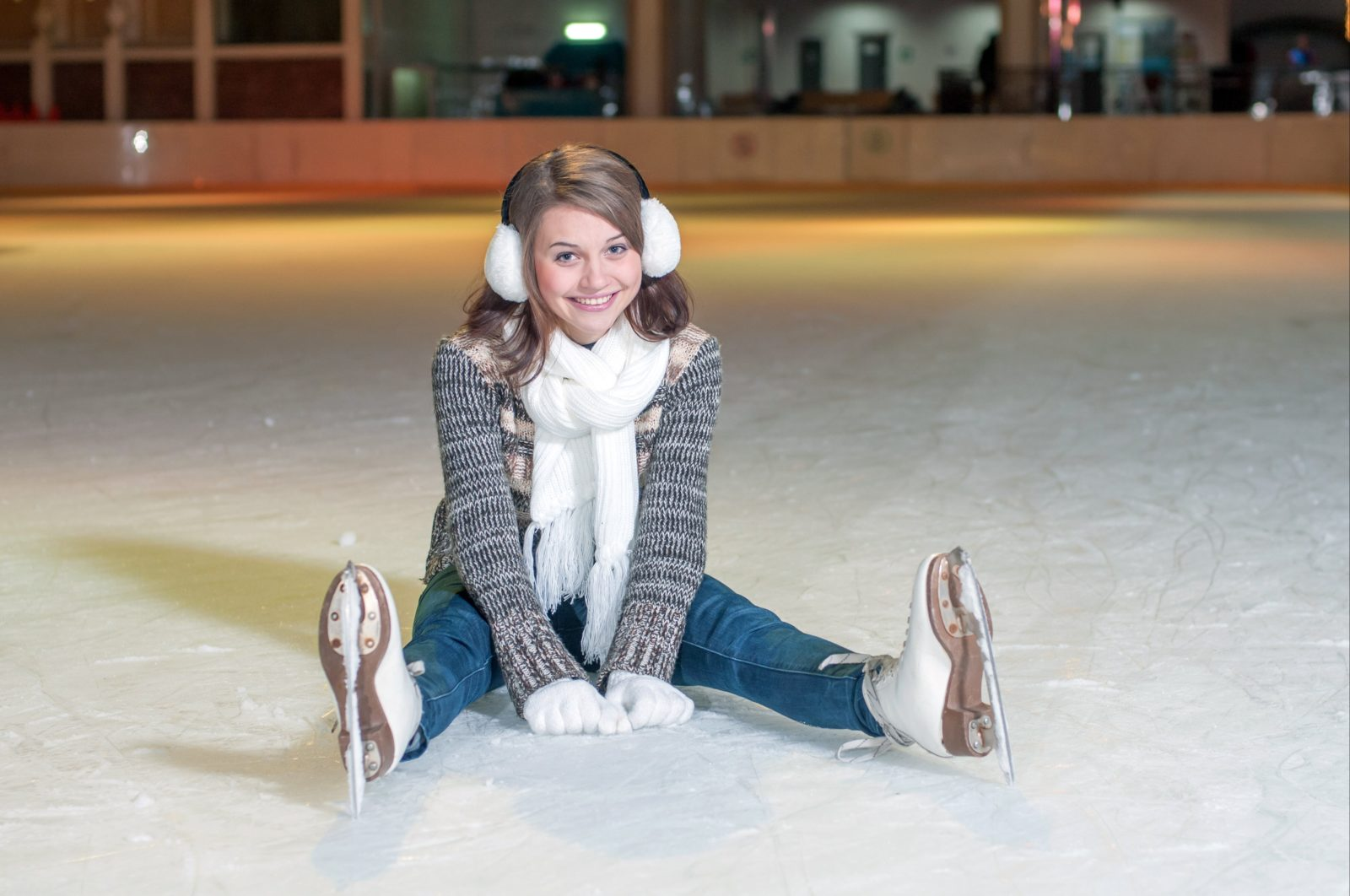 Image of a girl sitting on an ice rink