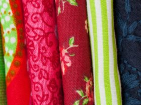 Close up of fabric lined up at market