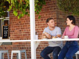 Couple enjoying meal on veranda