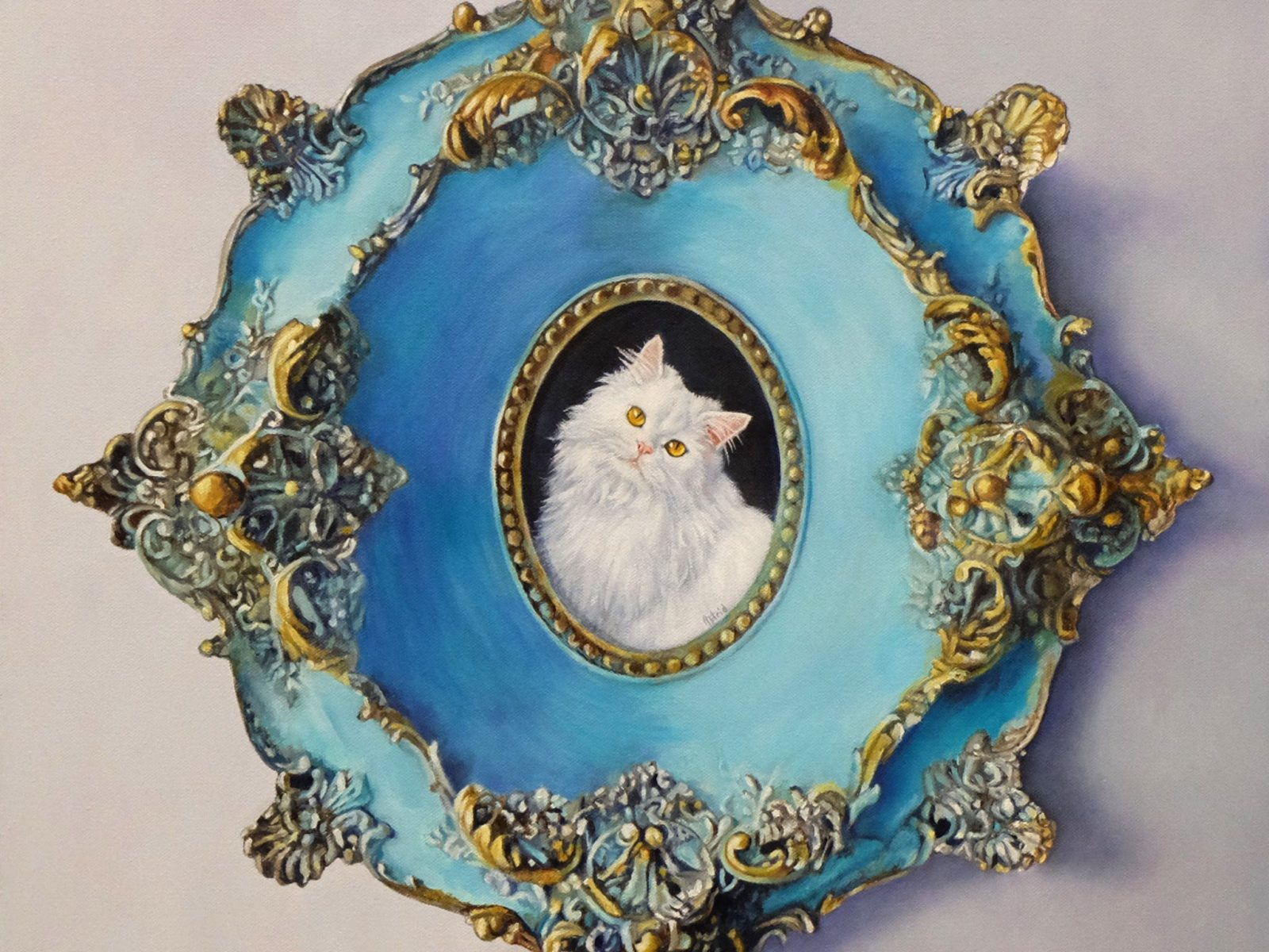 A painting of a white kitty cat in an elaborate turquoise gold detailed frame