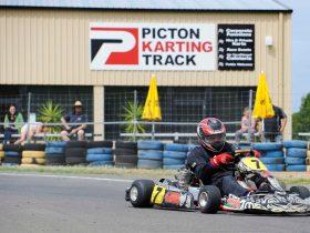 Guy riding kart around the track