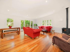 Lounge, dining, fireplace, floorboards, garden view