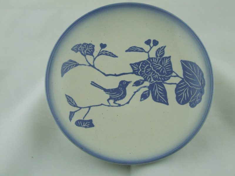 Platter with water-etched bluebird design