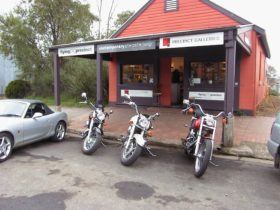 Precinct Galleries Shopfront with motorbikes and sports car