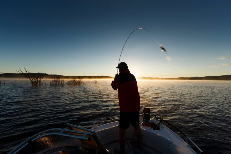 Fishing from a boat on Copeton Dam at Reflections Holiday Parks.