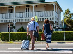 Couple walking towards check in at Riversleigh