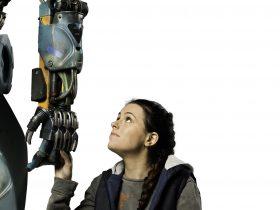 Girl holding robot's hand