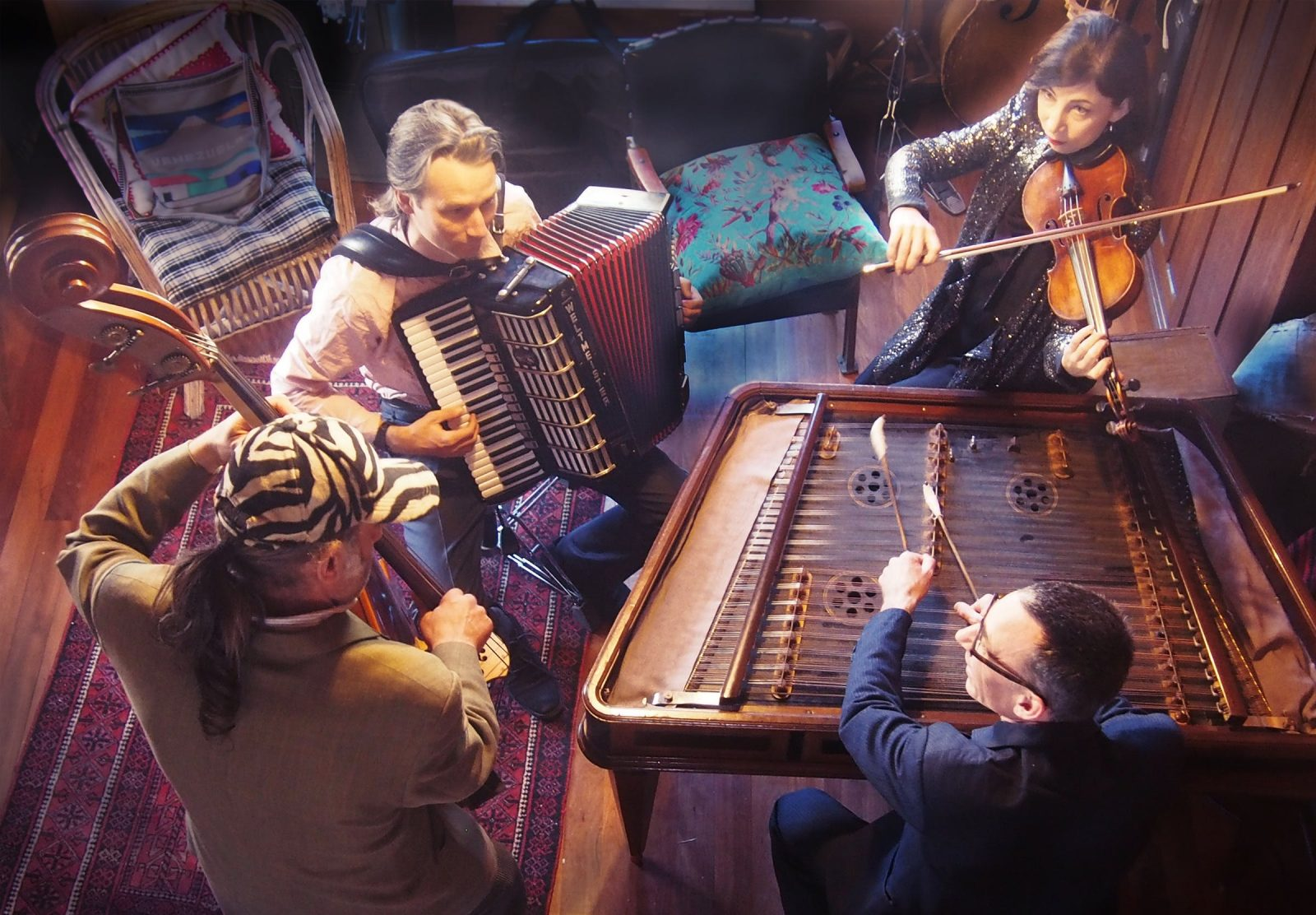 Photograph of the Super Rats Romanian band showing the unusual, many stringed cimbalom instrument