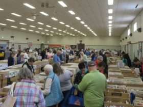 Depicts a view of the Hall at a Book Fair,