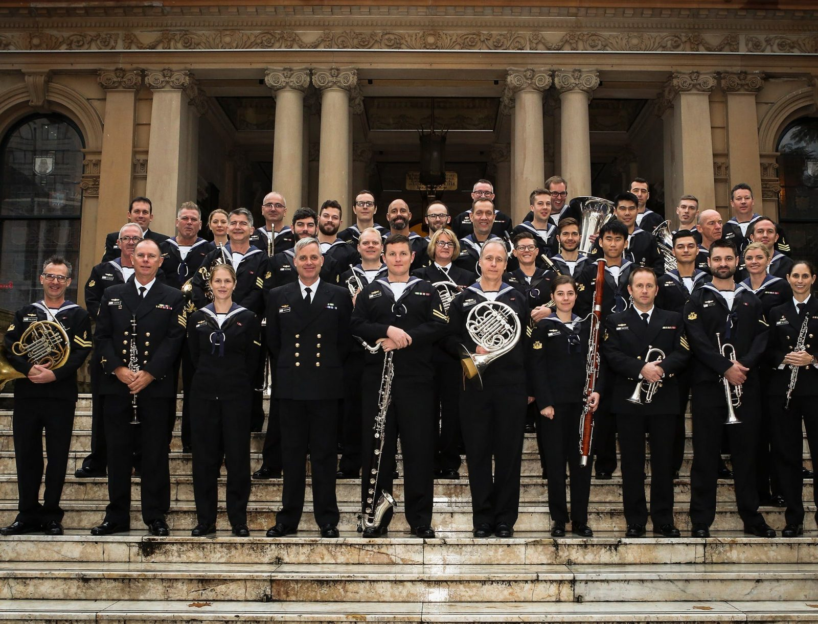 Band standing together on stairs