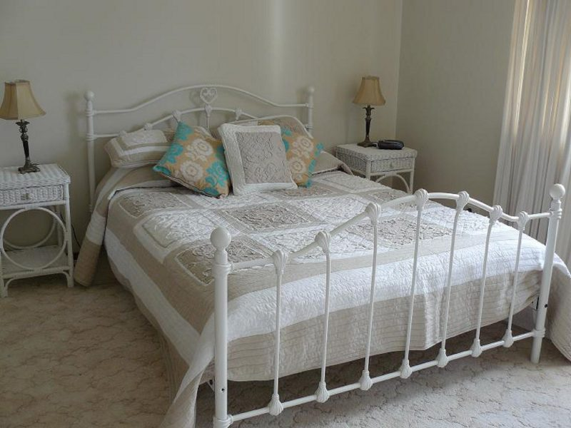 White metal Queen Bed with two bedside tables