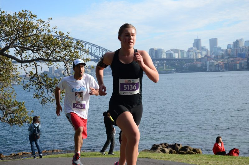 Two runners with Sydney Harbour Bridge in the background