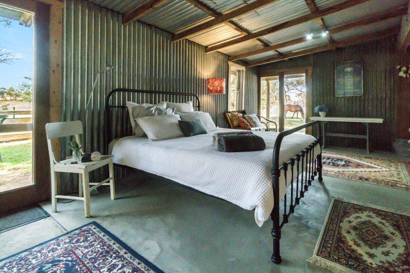 King bed bedroom rural outlook horses