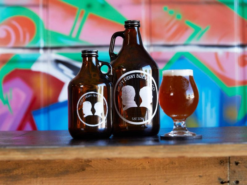 Rusty Penny branded bottles on bar