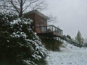 Mid-winter with cellar door in snow