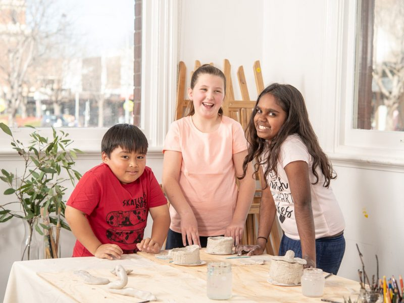 Children at table with clay
